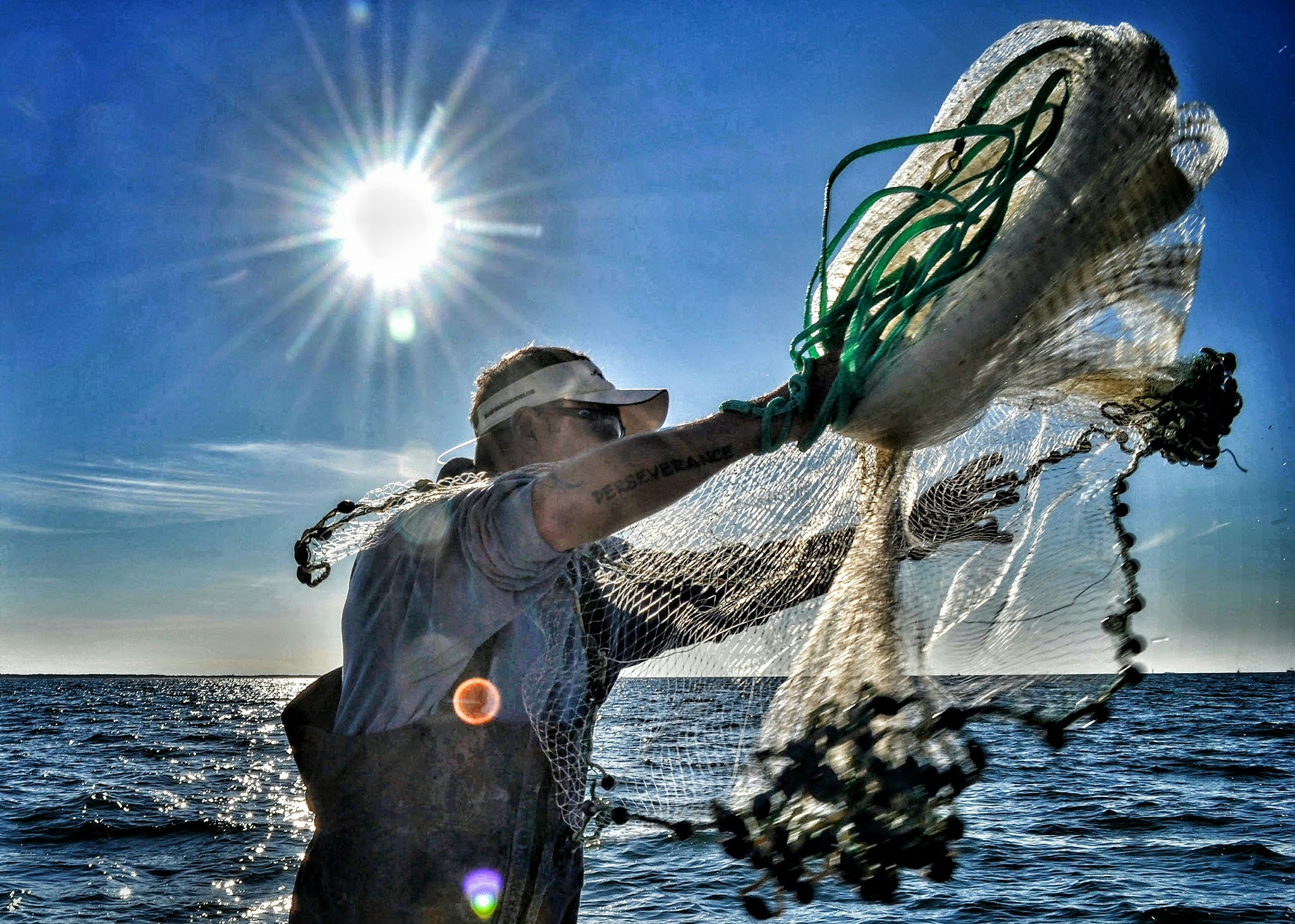 Captain Chris Kimrey Casts Net, Beaufort, NC